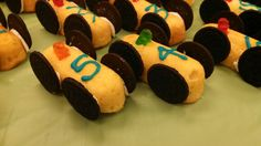My version of pinewood derby treats. Twinkes with oreo wheels, frosting numbers, and gummy bear drivers!