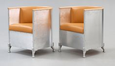 A pair of Mats Theselius 'Aluminium/Theselius' easy chairs, Källemo, Sweden post 1990. Polished aluminium, leather and beech