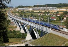 TGV 9580 Frankfurt (Germany) – Marseille is crossing the « Savoureuse Viaduct ». It is the longest bridge (792 metre) on the LGV Rhin-Rhône. At the horizon is Belfort-Montbéliard TGV station.