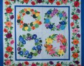 Quilt -- Wreaths of Daylilies, Nasturtiums, Morning Glories and Clematis Set Against Sky Blue Background