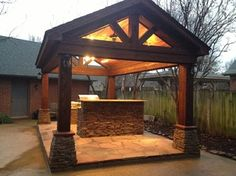 Exceptional Covered Outdoor Kitchen With Patio Area