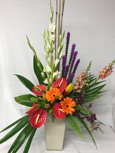 For my table in the foyer.  💜 Tropical Floral Arrangements, Christmas Floral Arrangements, Funeral Flower Arrangements, Funeral Flowers, Unique Flower Arrangements, Flower Centerpieces, Altar Flowers, Church Flowers, Table Flowers