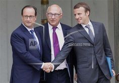rance's President Francois Holland, left, shakes hands with France's new Economy Minister Emmanuel Macron, right, as French finance minister Michel Sapin, centre, looks on, as they leave their weekly cabinet meeting, in Paris, Wednesday, Aug. 27, 2014. France's prime minister reshuffled his Cabinet on Tuesday to silence ministers who had openly criticized Socialist President Francois Hollande's economic policies. (AP Photo/Christophe Ena)