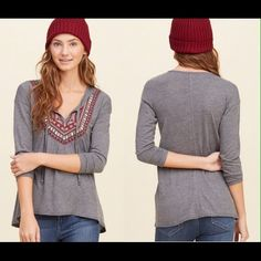 "Shine embroidered peasant top 70%polyester and 30% viscose ..Intricate and supersoft textural knit featuring embroidery at slit neckline with shine detailing and ties, an asymmetrical hem, Easy Fit, Imported  Model is 5'8"" wearing Size S... It runs true to size . Hollister Tops Tees - Long Sleeve"