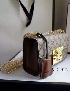 This bag is constructed in signature beige/ebony GG supreme canvas and structured flawlessly, with brown leather trim and a key lock closure which safeguards your personal belongings in fashion. View more Gucci collection at http://www.luxtime.su/gucci-bags