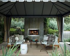 Design Your Home with Build Patio Canopy: Outdoor Concrete Fireplace In Wonderful Contemporary Patio Design With Container Plant And Covered Patio Also Decorative Cushions With Party Tent And Potted Plant Plus Wrought Iron Furniture For Build Patio Canopy ~ jangrue.com Exterior Design Inspiration