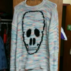 Rainbow skull sweater Live this rainbow skull sweater however it was given to me and was the wrong size. Super cute, XL, never worn Confess Sweaters