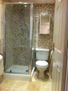 Christine from Oldbury uses colourful tiles to contrast his white furniture. Cheap Bathroom Remodel, Small Bathroom Renovations, Tiny Bathrooms, Bathroom Tile Designs, Tiny House Bathroom, Bathroom Interior Design, Small Bathroom Layout, Small Bathroom With Shower, Small Toilet Room