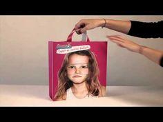 Bolsa Joupi, diseño de bolsa que permite cambiar la expresión del niño estampado