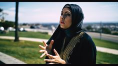 Muslim woman sitting at a Park I'd recently interviewed in Long Beach CA. [OC] [1920x1080]