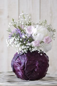 Such a neat idea for a natural vase. #flowers #vegetables #arrangements