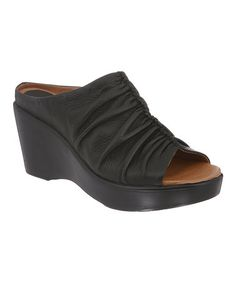 Take a look at this Black Eva Peep-Toe Slide by Kravings by Klogs on #zulily today! $54.99, regular 125.00.  PRODUCT DESCRIPTION: Tantalize toes with these comfortable treats boasting Klog's signature Komfort technology. Supple on the outside and contoured within to provide excellent arch support, this pair of slip-resistant slides features an antimicrobial footbed that keeps feet feeling sweet.   3.5'' heel Leather upper Leather lining Man-made sole Imported