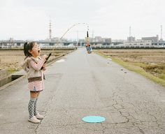 Nagano Toyokazu takes imaginative photos of his girls. In this one she is fishing.