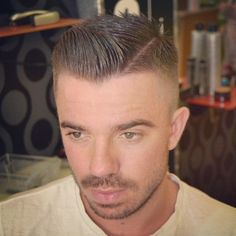 unnamed model with slick haircut and stubble