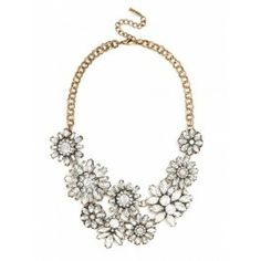 A dazzling array of geometric silhouettes forms a covetable, ornate statement piece. Statement necklace from @BaubleBar
