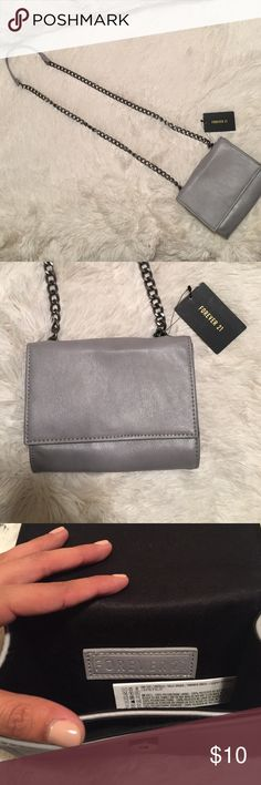 Forever 21 Grey crossbody purse!! Never worn before! Still has tags!! Really cute small grey purse ✨✨ Forever 21 Bags Crossbody Bags