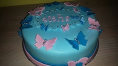 butterfly cake.  light blue, pink and dark blue
