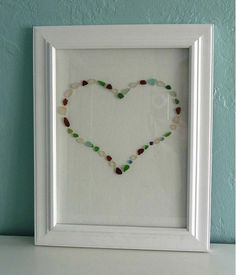 Turn vacation finds into art with this beach glass art tutorial!