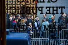 Pedestrians passed behind barricades across the street from Trump Tower in New York on Friday. - Ruth Fremson/The New York Times