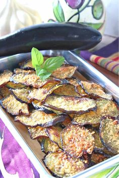 These delicate but Crispy Baked Eggplant Chips are packed with flavor thanks to a light brushing of homemade basil-infused olive oil, and grated Parmesan cheese. #eggplant #eggplantchips #vegetablechips #appetizer #easyappetizer #vegetarianrecipe #parmesancheese #roastedeggplant #vegetablesnacks #plantbasedrecipe #lowcarbsnacks #ketosnacks #kudoskitchenrecipes #cookingwithfreshbasil #infusedoliveoil #auberginechips #bakedauberginechips Eggplant Chips, Baked Eggplant, Roast Eggplant, Clean Foods, Clean Recipes, Low Carb Recipes, Vegetarian Recipes, Vegetable Chips, Vegetable Snacks