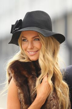 Very elegant with her beautiful long hair, her cute fedora, fur and natural make-up....