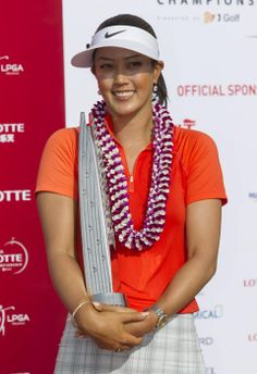 Michelle Wie holds her 2014 in LPGA LOTTE Championship golf tournament trophy after winning the tournament at Ko Olina Golf Club, Saturday, April 19, 2014, in Kapolei, Hawaii. (AP Photo/Eugene Tanner) http://news.yahoo.com/photos/michelle-wie-holds-her-2014-lpga-lotte-championship-photo-224116274.html  ▼19Apr2014APviaYahoo!Sports|Wie finally wins an LPGA event at home http://sports.yahoo.com/news/wie-finally-wins-lpga-event-211617498--golf.html #Michelle_Wie