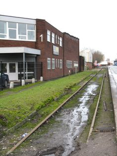 Disused Industrial Railway and Offices, Trafford Park Road by Peter Whatley, via Geograph