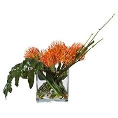 Faux pincushion protea in clear vase.  Product: Faux floral arrangementConstruction Material: Fabric, acrylic and glassColor: OrangeFeatures: Realistic faux waterDimensions: 17 H x 20 W x 6 D Cleaning and Care: For indoor use only. Wipe with feather duster or damp rag.