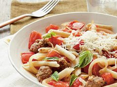 Fresh Tomato, Sausage, and Pecorino Pasta | Ripe, late-summer tomatoes are juicy and delicious in this entrée, with no seeding or peeling necessary.