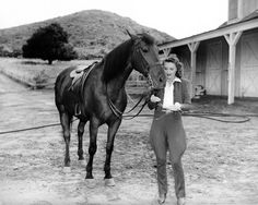 0 Barbara Stanwyck with black horse in a publicity photo for Cry Wolf 1947.