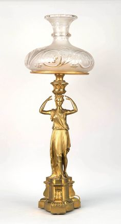 Gilt metal classical figure sinumbra (sperm oil) lamp with frosted and cut glass shade