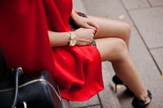 red cape and black strap heels