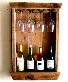 Own a piece of American history with this Barn Wood Wine Bottle Rack. Very Rustic Wine Rack, and Wine Glass Holder. This Rack sets about 3/4 off the wall. The wood came from a Barn in Michigan. The wood is very rustic and full of character with different shades of brown. I have left the wood natural with no finish added (it has been washed). I figure Mother Nature did a pretty good job on the finish over the last 100 years or so and you are left with the most authentic and natural ...