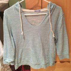 Hooded crop sweater Light blue hooded sweater. Super comfy!! Size larger but runs very small (I usually wear a small and this fits perfectly) Tops Sweatshirts & Hoodies