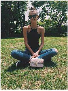 Taylor Hill • black top and jeans