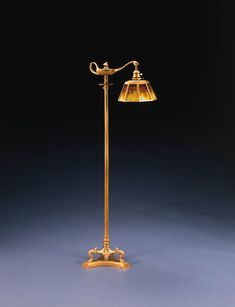 AN OVERLAID AND ETCHED GLASS AND GILT-BRONZE FLOOR LAMP   Tiffany Studios   54in. (137.2cm.) high, 9in. (23.5cm.) diameter of the shade   the shade stamped TIFFANY STUDIOS NEW YORK 1407, the 'aladin' base stamped TIFFANY STUDIOS NEW YORK 576