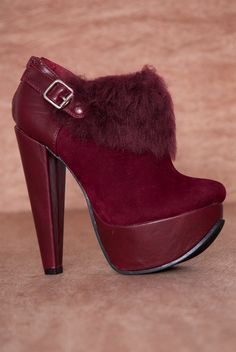 These posh burgundy faux suede platform ankle booties are a trendy way to add texture and style to your outfit with faux fur trim a buckled harness strap and a half cone heel