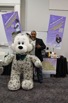 Mark Ress of Blitz Media Marketing having some fun posing for picture #5  with the Money Bear at the I.E. Largest Mixer 2011
