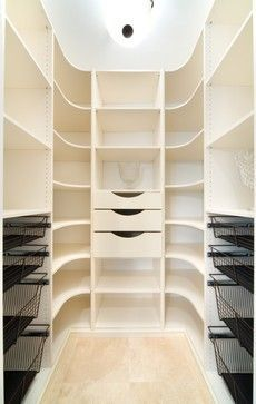 closet with rounded shelves