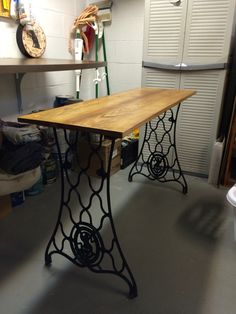 Table with Singer sewing machine legs