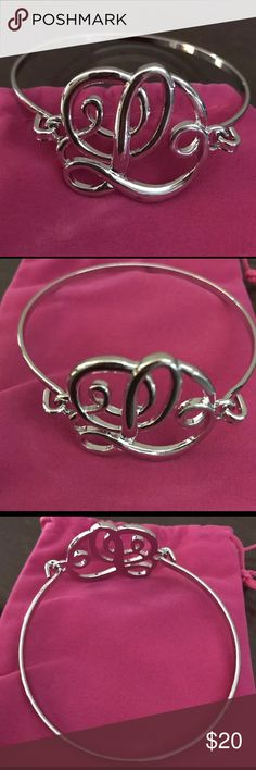 Monogram Silver Initial L Script Bracelet Pouch This elegant bracelet makes a beautiful statement that can be styled and worn with any of your favorite outfits. A great piece to share as a thoughtful gift on any special occasion. Available in Silver with a meaningful monogram initial to feature everything that means the most to you.   Bracelet Lenght : 8in Ashley Jewelry Bracelets