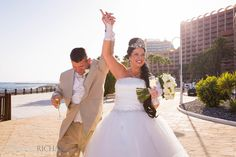 Bride and Groom enter at Sunset Beach Club Promenade