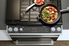 A black gas cooktop, shown from above, combined with an oven.