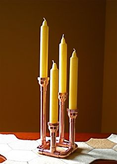 This candelabra holds four standard one inch tapers. This is a unique conversation piece, a perfect 7th wedding anniversary gift, or something for your favorite guys apartment. A beautiful simple use of copper fittings. This will enhance any table or mantle. Easily polished with any copper cleaner or allow it to age gracefully. Please note there are imperfections in the copper which add to the beauty of each piece. This is an order for a candlestick in the design pictured. Please allow 3…