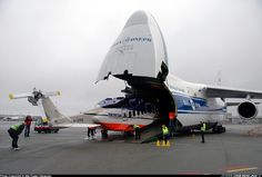 An-124 delivering a brand new S-92 helicopter.