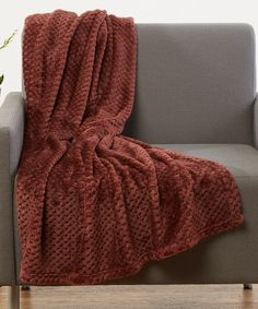 """Dark Brown Popcorn Fleece Throw. . ...  Hotel Elements. . ...  $14.99 $24.99  . 50"""" x 60""""  . : Product Description:  Snuggle up with popcorn, a movie and this ultracozy fleece throw made in a solid color to complement your home.      50'' x 60''  .     Polyester  .     Machine wash  .     Imported"""