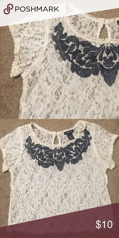 white lace crop top a little bit used but still in good shape. white lace crop top with navy design. Rue21 Tops Crop Tops