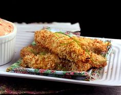 Crunchy Baked Coconut Lime Chicken Strips with Spicy Greek Yogurt Dipping Sauce.