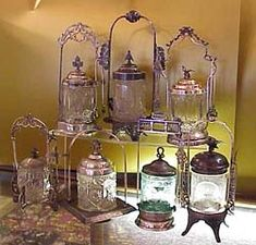 ....antique pickle castors.... These  were used in privileged homes to serve pickles in formal dining rooms.  It was considered the height of elegant dining in the Victorian era to have one or two, if the family was very wealthy, pickle castors on the dining room table when serving a meal.  They usually consist of a silver plated frame fitted with a glass insert, and matching silver plated lid. Some had matching silver plated tongs and/or pickle fork.  Inserts are to be found in pattern…