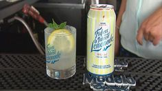 Fishers Island Lemonade served with a wedge of lemon and a sprig of mint.